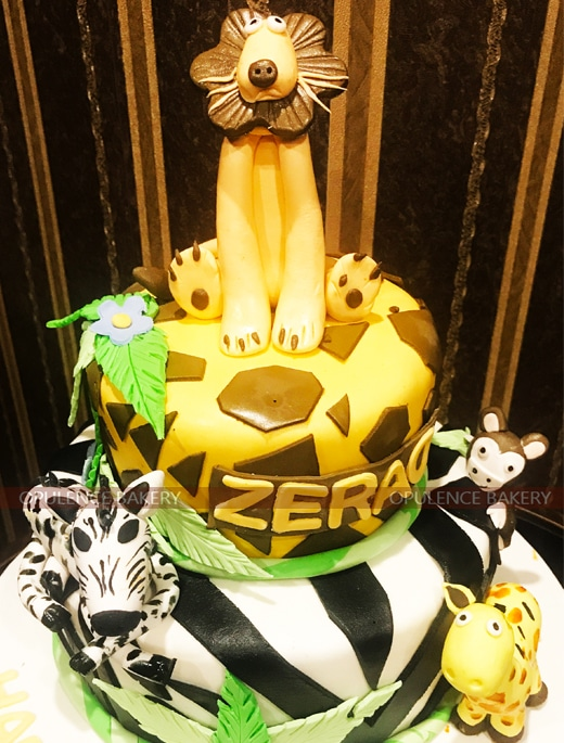 lion jungle themed cake in 2 tiers