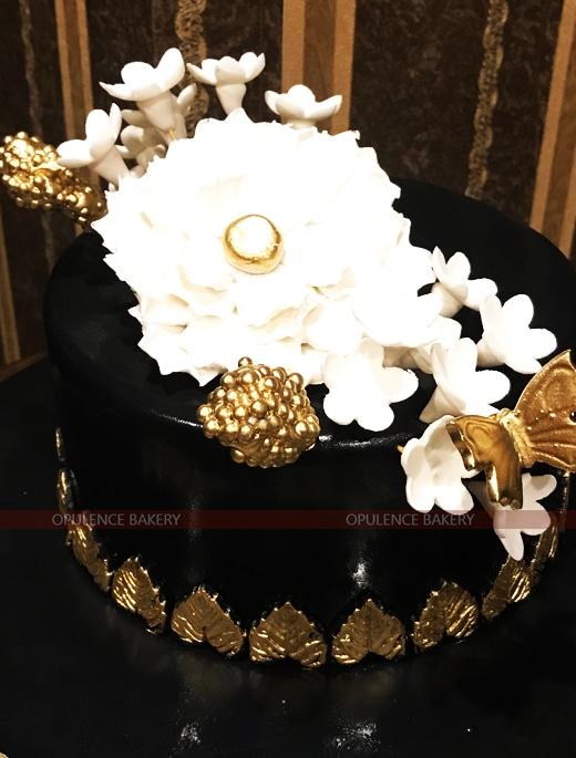 elegant white golden black cake